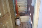 an eco-friendly toilet, complete with hay